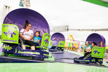 Spinning around on the Tilt-a-Whirl, Ariel Hoffman and her daughter Addison Valdez can't help but smile and laugh as well as riders Hannah Hall, Ashley Eanes, and Katelyn Atchley in the second car during the Lion's Club Carnival May 11. (Sydney Warner/Montrose Daily Press)