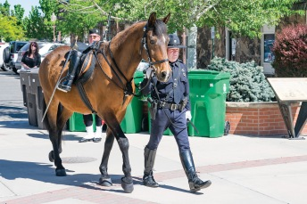 Leading the Riderless Horse, Officer Ted Holland from the Mountain Village Police Department walks across the Centennial Plaza during Western Colorado Law Enforcement Officers Memorial Day on May 15. (Sydney Warner/Montrose Daily Press)